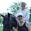 Erin Briggs with Friend Val and Shadow the Horse.jpg