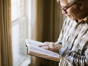 medicare man with bible.jpg